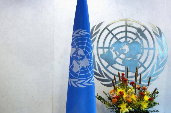 A United Nations logo and flag are seen during the U.N. General Assembly at U.N. Headquarters in New York