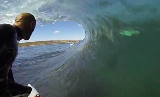 Pro Surfer's GoPro Footage Captures Shadowy Figure in the Water Alongside Him