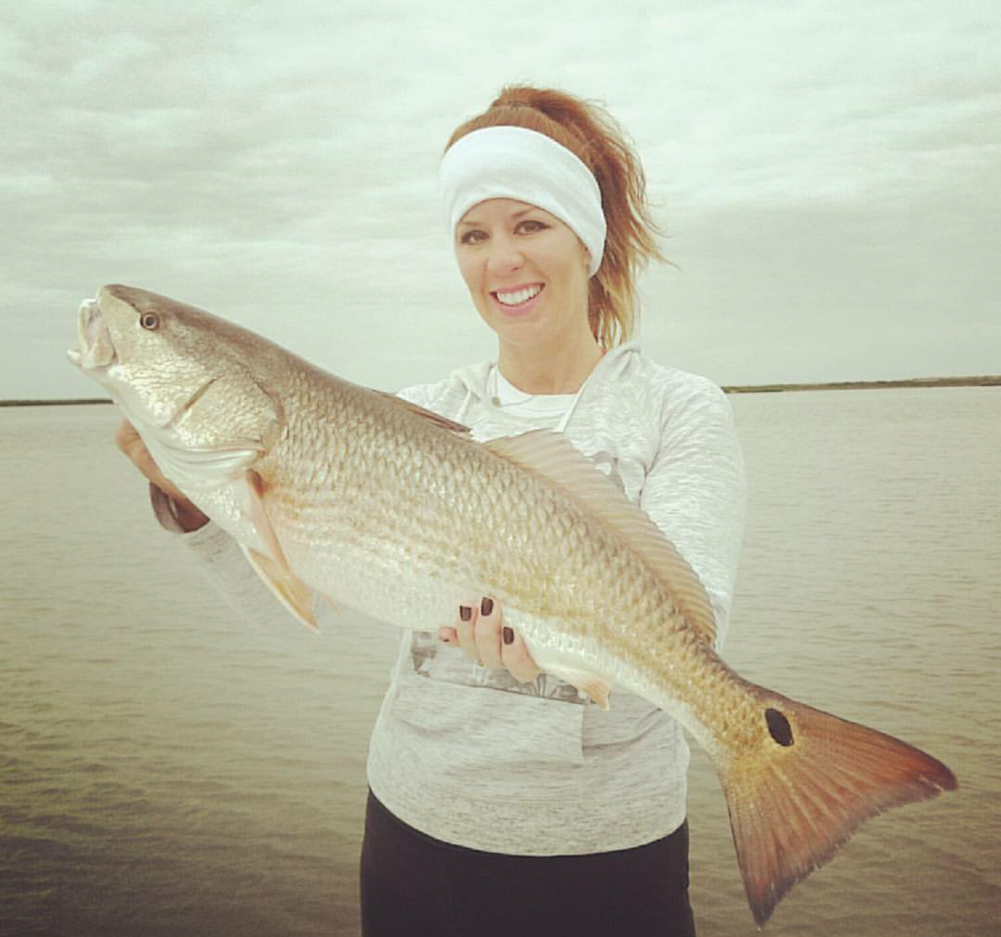 Redhead catching big reds in SPI
