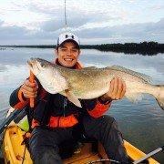 34″ trout landed on kayak