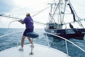 Keith Warren hooks into a monstrous king while fishing spoonfish behind a shrimp boat six miles off the Sabine Jetties.