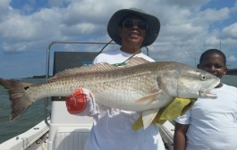 Lady Angler First Redfish was a 38 Incher - Texas Hotshots